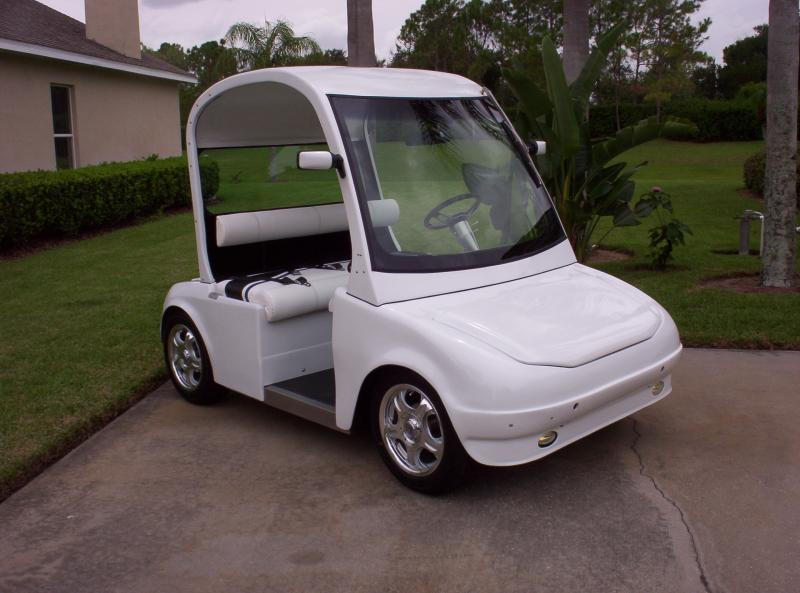 "3 passenger "" Splash"" Lectric Limo's solar electric low speed vehicle"